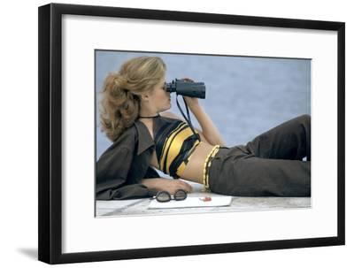 Model Is Reclining Wearing Brown Pant Suit with Yellow and Brown Halter by Ken Scott-Gianni Penati-Framed Premium Giclee Print