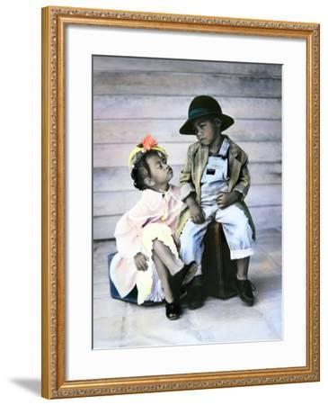 Boy and Girl Sitting on Luggage-Nora Hernandez-Framed Giclee Print