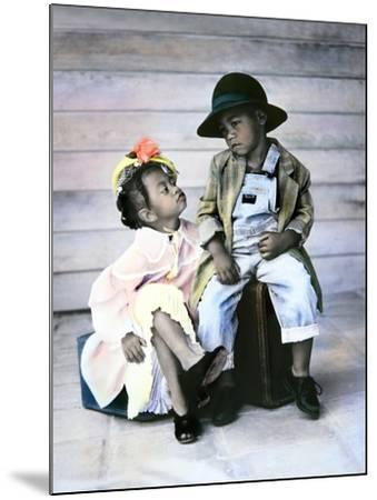 Boy and Girl Sitting on Luggage-Nora Hernandez-Mounted Giclee Print