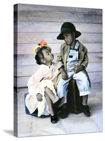 Boy and Girl Sitting on Luggage-Nora Hernandez-Stretched Canvas Print