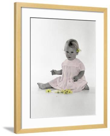Little Girl Sitting with Flower Tucked Behind Her Ear-Nora Hernandez-Framed Giclee Print