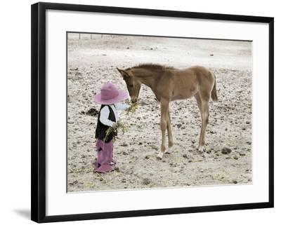 Child in Western Wear Feeding a Pony-Nora Hernandez-Framed Giclee Print