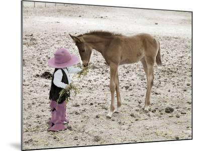 Child in Western Wear Feeding a Pony-Nora Hernandez-Mounted Giclee Print