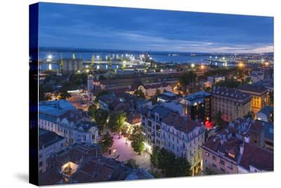 Bulgaria, Black Sea Coast, Burgas, Elevated City View. Dusk-Walter Bibikow-Stretched Canvas Print