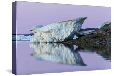 Canada, Nunavut, Iceberg Reflected in Calm Waters at Dusk-Paul Souders-Stretched Canvas Print