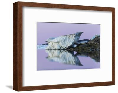 Canada, Nunavut, Iceberg Reflected in Calm Waters at Dusk-Paul Souders-Framed Photographic Print