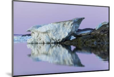 Canada, Nunavut, Iceberg Reflected in Calm Waters at Dusk-Paul Souders-Mounted Photographic Print