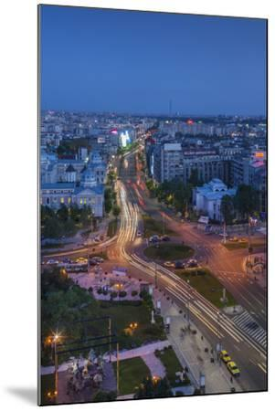 Romania, Bucharest, Piata Universitatii, Coltea Hospital at Dusk-Walter Bibikow-Mounted Photographic Print