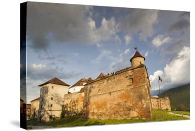 Romania, Transylvania, Brasov, Brasov Citadel, Sunset-Walter Bibikow-Stretched Canvas Print