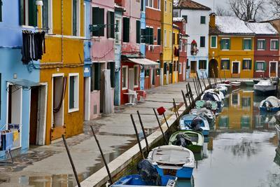 Boats Docked Along Canal with the Colorful Homes of Burano, Italy-Darrell Gulin-Framed Photographic Print