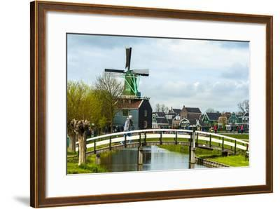A Bridge Leading to a Village of Historic Homes in the Netherlands-Sheila Haddad-Framed Photographic Print