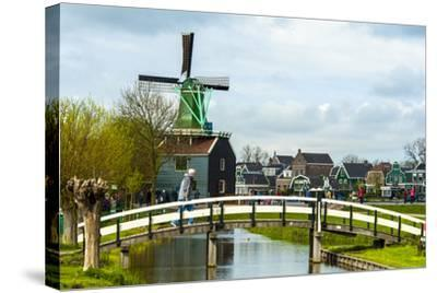 A Bridge Leading to a Village of Historic Homes in the Netherlands-Sheila Haddad-Stretched Canvas Print