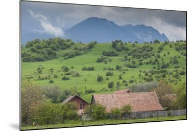 Romania, Transylvania, Bran, House and Bucegi Mountains, Spring-Walter Bibikow-Mounted Photographic Print