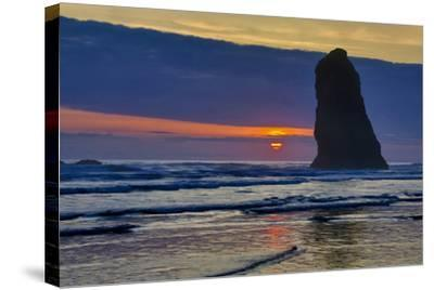 USA, Oregon, Cannon Beach. Sunset on Lone Seastack-Jean Carter-Stretched Canvas Print