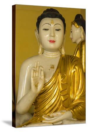 Myanmar. Yangon. Shwedagon Pagoda. Buddha in the Discussion Mudra-Inger Hogstrom-Stretched Canvas Print