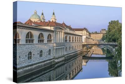 Slovenia, Ljubljana, Ljubljana River and Old Town at Dawn-Rob Tilley-Stretched Canvas Print