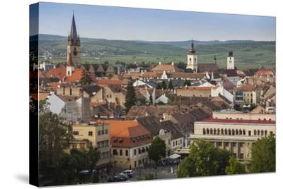 Romania, Transylvania, Sibiu, Elevated City View, Late Afternoon-Walter Bibikow-Stretched Canvas Print