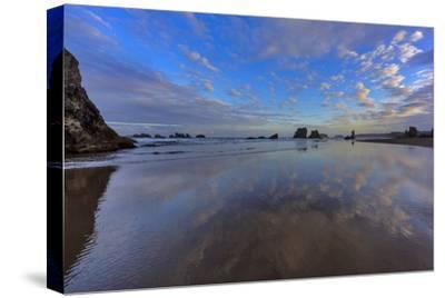 Clouds Reflect in Wet Sand at Sunrise at Bandon Beach, Bandon, Oregon-Chuck Haney-Stretched Canvas Print