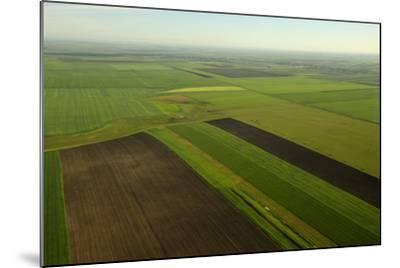 Communist-Era Collective Farm Fields in Romania-Kenneth Garrett-Mounted Photographic Print