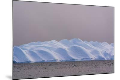 An Iceberg in Ilulissat Icefjord, an UNESCO World Heritage Site, on a Cloudy Day-Sergio Pitamitz-Mounted Photographic Print