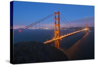 Lights on the Golden Gate Bridge at Dusk-Jeff Mauritzen-Stretched Canvas Print