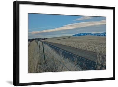 A Road Cuts Through Harvested Wheat Fields as Lenticular Clouds Hover over the Bridger Mountains-Gordon Wiltsie-Framed Photographic Print