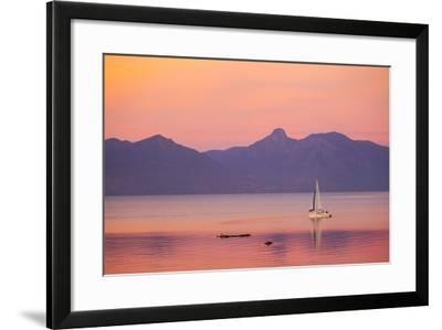 A Sailboat in Lake Villarrica's Flat Calm Water with Small Ripples, at Sunset-Mike Theiss-Framed Photographic Print