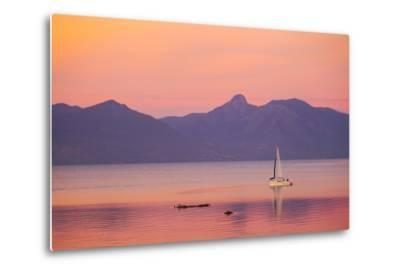 A Sailboat in Lake Villarrica's Flat Calm Water with Small Ripples, at Sunset-Mike Theiss-Metal Print