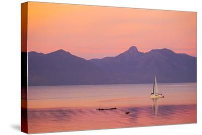 A Sailboat in Lake Villarrica's Flat Calm Water with Small Ripples, at Sunset-Mike Theiss-Stretched Canvas Print