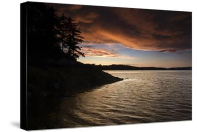 Turbulent Clouds over Water are Cast with Fiery Yellows and Oranges at Sunset-Robbie George-Stretched Canvas Print
