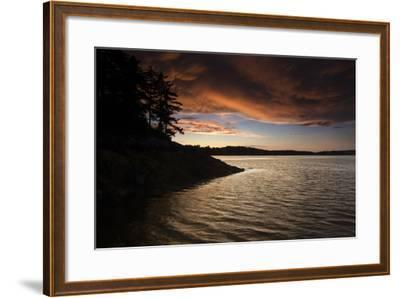 Turbulent Clouds over Water are Cast with Fiery Yellows and Oranges at Sunset-Robbie George-Framed Photographic Print