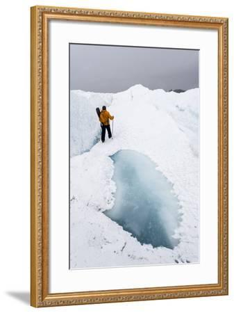 A Hiker Passing Between a Dangerous Crevasse and a Melt Pond on the Greenland Ice Shelf-Jason Edwards-Framed Photographic Print