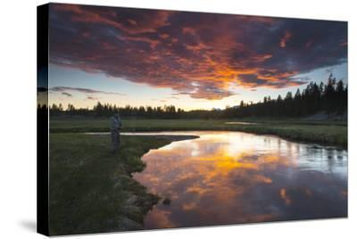A Fisherman Tries His Luck under a Radiant Sky at Dusk-Robbie George-Stretched Canvas Print