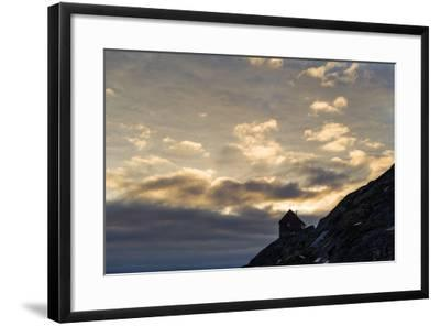 The Silhouette of a Cottage Perched on a Rocky Outcrop on an Arctic Island-Jason Edwards-Framed Photographic Print