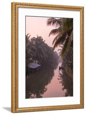 Sunset Creates a Beautiful Pink Hue in the Backwaters-Kelley Miller-Framed Photographic Print