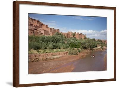 A Man on a Donkey Crossing the River in Front of Ait Benhaddou, Morocco-Erika Skogg-Framed Photographic Print