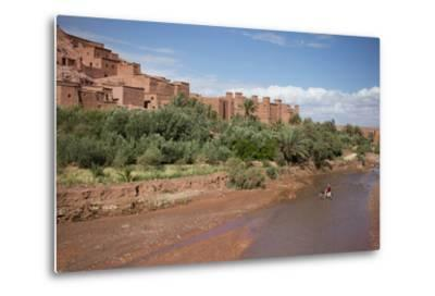 A Man on a Donkey Crossing the River in Front of Ait Benhaddou, Morocco-Erika Skogg-Metal Print