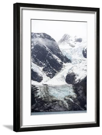 A Jagged Glacier Tongue Recedes Up and Rugged and Inhospitable Mountain Gorge in a Fiord-Jason Edwards-Framed Photographic Print