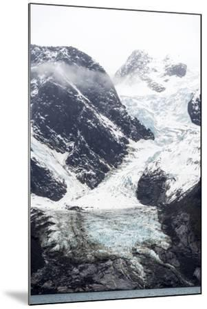 A Jagged Glacier Tongue Recedes Up and Rugged and Inhospitable Mountain Gorge in a Fiord-Jason Edwards-Mounted Photographic Print