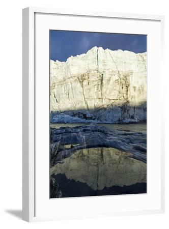 The Setting Sun Reflects the Sheer Ice Cliff of a Glacier Fracture Zone in a Pond-Jason Edwards-Framed Photographic Print
