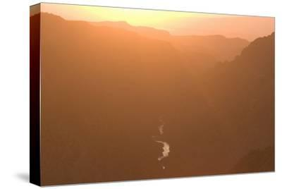 The Gunnison River Winds Through a Canyon from the South Rim of Black Canyon-Phil Schermeister-Stretched Canvas Print