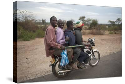 A Motorcycle Taxi Near the Town of Kasese in Uganda-Joel Sartore-Stretched Canvas Print