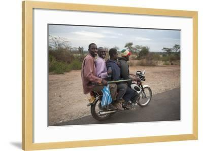 A Motorcycle Taxi Near the Town of Kasese in Uganda-Joel Sartore-Framed Photographic Print