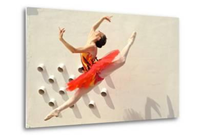 A Ballerina Dancing and Leaping Wearing a Red Dress-Kike Calvo-Metal Print