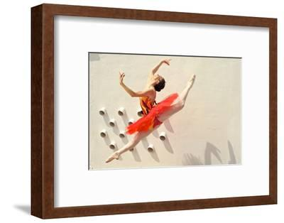 A Ballerina Dancing and Leaping Wearing a Red Dress-Kike Calvo-Framed Photographic Print