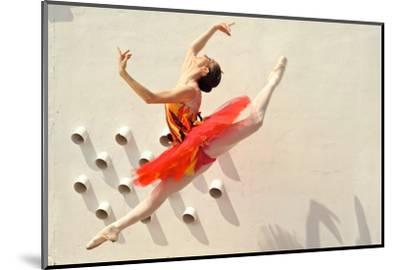 A Ballerina Dancing and Leaping Wearing a Red Dress-Kike Calvo-Mounted Photographic Print