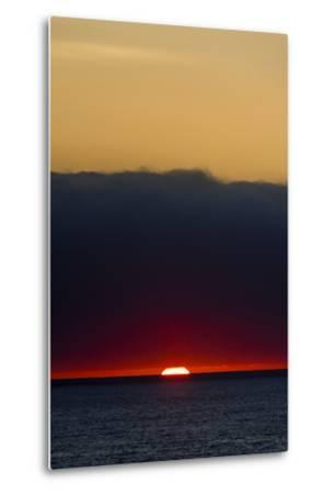 A Slither of Sunlight Pierces a Storm Cloud Above a Darkened Ocean at Sunset-Jason Edwards-Metal Print