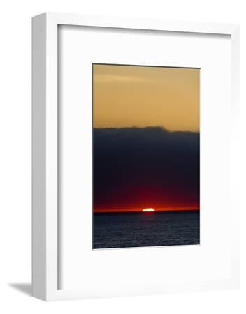 A Slither of Sunlight Pierces a Storm Cloud Above a Darkened Ocean at Sunset-Jason Edwards-Framed Photographic Print