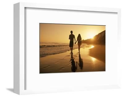 A Couple Walking on the Beach at Sunset-Macduff Everton-Framed Photographic Print