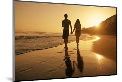 A Couple Walking on the Beach at Sunset-Macduff Everton-Mounted Photographic Print